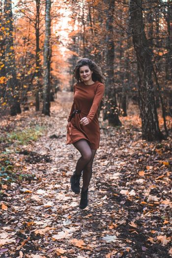Jump Jumping Curly Hair Dancing Orange Clothes Happiness Happy Fall Autumn Tree Land Forest One Person Clothing Young Adult Adult Nature Full Length Portrait Front View Young Women Women Fashion Beauty Hair
