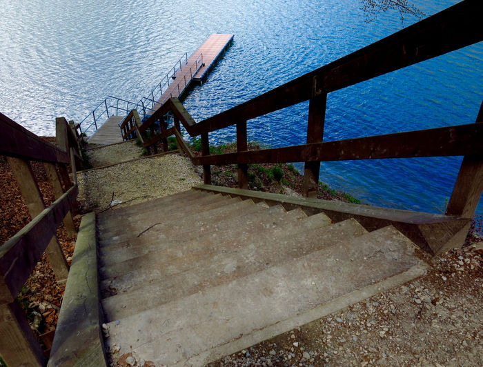 Downwards Lake View Light And Shadow No People Outdoors Railing _ Collection Stairways View From Above Waterfront
