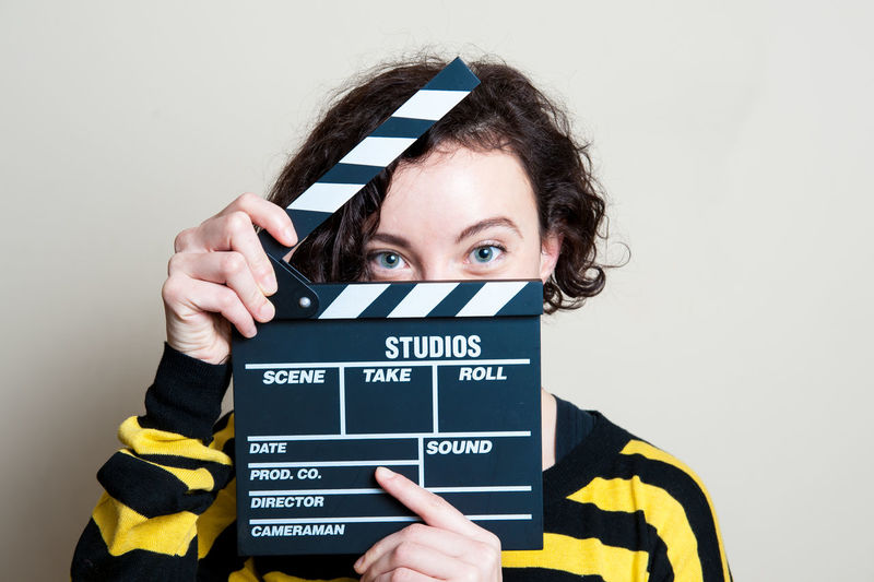 Portrait Of Woman With Movie Clapperboard
