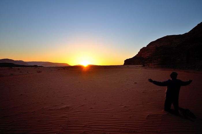Beauty In Nature Clear Sky Desert Sunrise Energy Full Length Landscape Leisure Activity Lifestyles Men Nature One Person Outdoors Real People Sand Sand Dune Scenics Silhouette Sky Sun Sunlight Sunrise Tranquil Scene Tranquility Travel Destinations Vacations