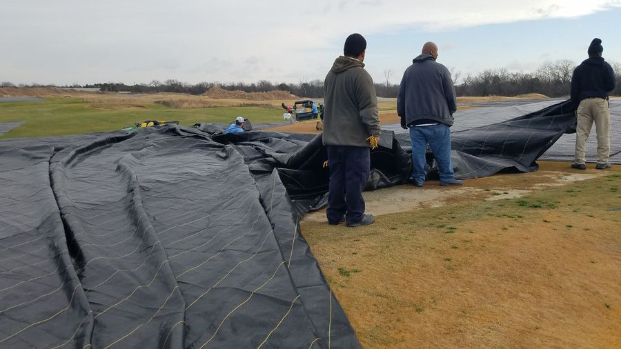 Five minute break from tarping greens. Hard Workers Trinity Forest Golf Course Golf Course Mature Adult People Adult Only Men Mature Men Day Adults Only Men Teamwork Outdoors Business Stories