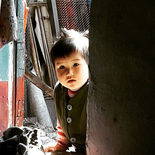 I was visiting a very poor family. And as we were siting there listening to their lifestory, this little guy looked through the window First Eyeem Photo