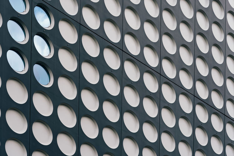 Circles pattern facade Abstract Aluminum Architectural Detail Architecture Array Backgrounds Building Building Exterior Circles Cityscape Close-up Day Façade Full Frame Indoors  Modern Architecture No People Office Building Pattern Steel