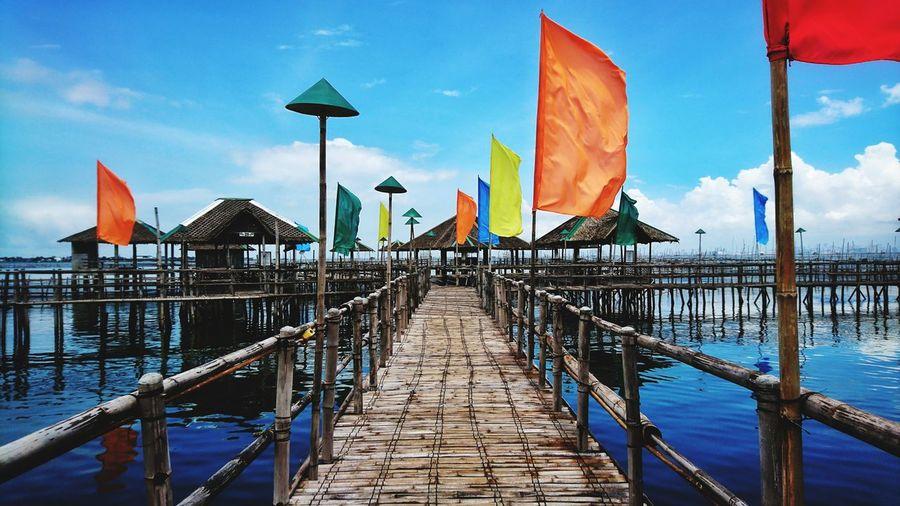 Eyeem Philippines Seascape Bluesky Blue Sky Sky Resorts Beach Water Sea Flag Sky Architecture Cloud - Sky Wooden Post Stilt House