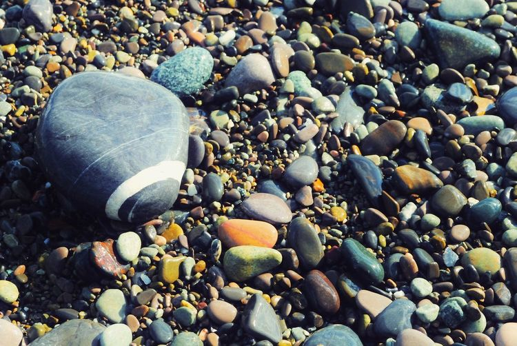 Large Group Of Objects High Angle View Abundance Outdoors Pebble Beach No People Day Pebble Beach Close-up Backgrounds Nature Sea Pebble Beach Pebbles And Stones Pattern Pieces Pebbles Beach Pebbles Pattern Patterns In Nature Beauty In Nature Stones Full Frame
