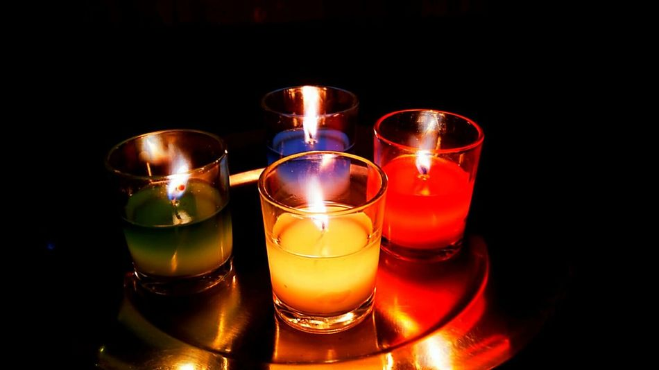 Shot candles used on Diwali Diwali Celebration Night Illuminated No People Indoors  Electronic Aperture Mode Candles Black Background Halo EyeEmNewHere Eye4photography  EyeEm Best Shots Photo Taken From Smartphone Camera Nubiaz11minis