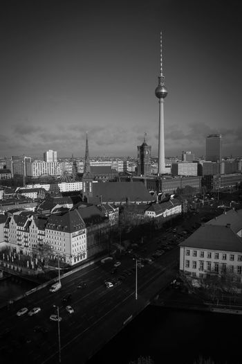 High Angle View Of Fernsehturm Amidst Buildings In City Against Sky
