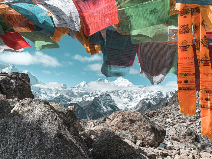 Prayer flags against snowcapped mountains
