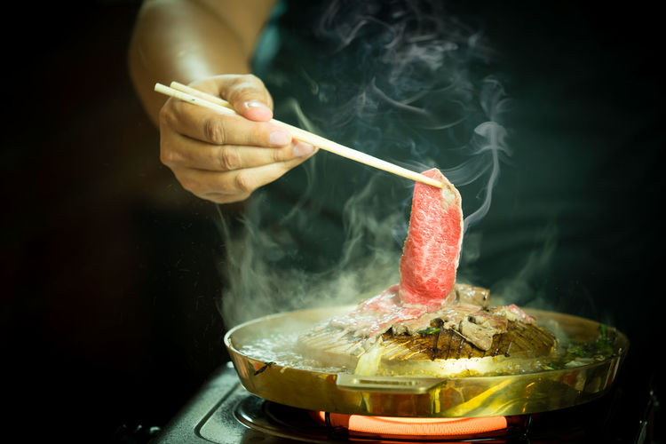 Korean barbecue or Yakiniku in japanese style BBQ Beef Cooking Cuisine Dinner Hot Japan Korean Meal Pork Smoke Asian Food Barbecue Buffet Chopsticks Delicious Fat Fire Food Grill Healthy Eating Meat Pan Restaurant Shabu