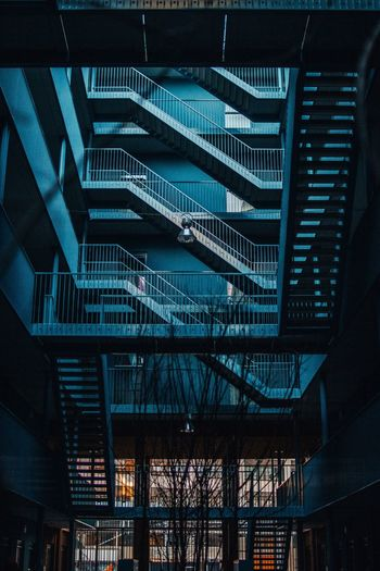 Staircase to ... Industrial Stairs Staircase Architecture Built Structure Building Exterior Night Building No People City Low Angle View Railing Outdoors Metal Modern Blue Bridge 17.62°