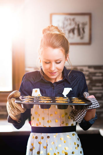 Smiling Woman Holding Cookies In Tray