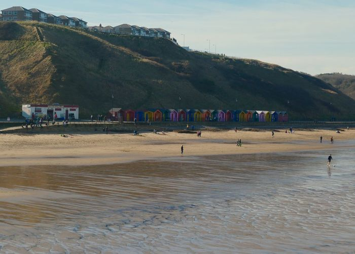 British seaside and huts! EyeEm Selects Beach Hut Land Mountain Tree Beach Plant Nature Large Group Of People Crowd Water Sky Group Of People Beauty In Nature Scenics - Nature Day Real People Landscape Environment Outdoors Women