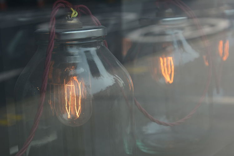Glass - Material Transparent Light Bulb Lighting Equipment Filament Illuminated Electricity  Close-up Light Glowing Indoors  Electric Light Reflection Window Electric Lamp Hanging Technology 17.62°