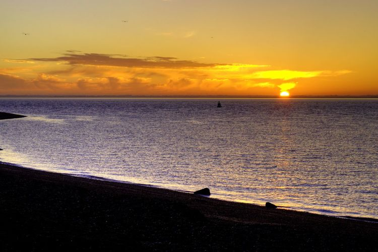 Languard point sunset. Sunset Sea Beach Sun Orange Color Beauty In Nature Scenics Sky Water Nature Horizon Over Water Tranquility Wave Cloud - Sky