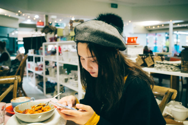 Real People One Person Indoors  Focus On Foreground Restaurant Food Food And Drink Women Lifestyles Adult Business Portrait Waist Up Headshot Mid Adult Table Leisure Activity Incidental People Kitchen Utensil Hairstyle