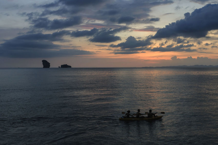 People kayaking at Sunset near Railay beach in Krabi, Thailand Ao Nang Infinity Pool Krabi Luxury Hotel Maya Bay Railay Thailand Beach Losama Bay Palm Trees Paradise Phi Phi Island Resort Summer Water