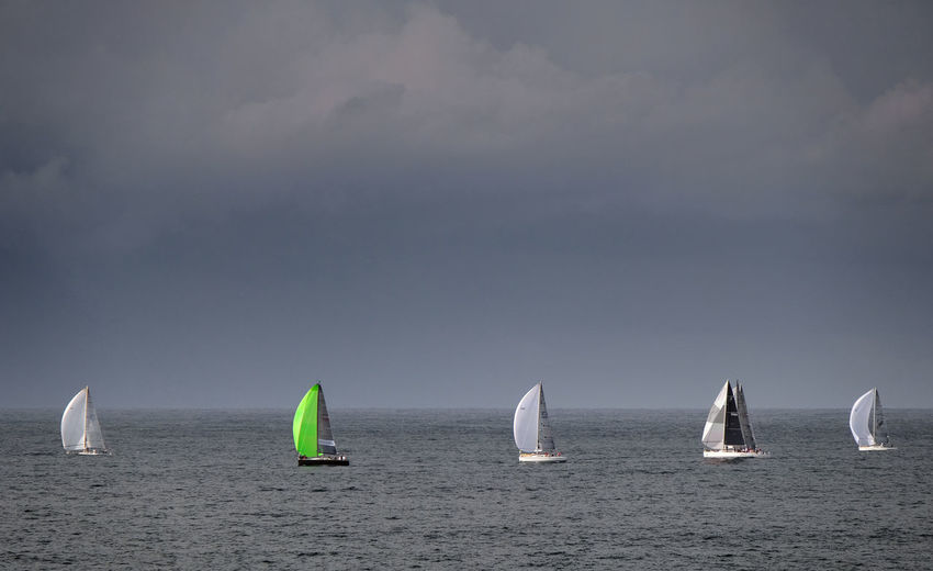 Sydney New South Wales  Water Sea Sky Sailboat Nautical Vessel Horizon Over Water Transportation Horizon Cloud - Sky Sailing Mode Of Transportation Sport Outdoors Floating On Water Green Lime Storm Cloud Stormy Sky Five One Of A Kind  Odd One Out