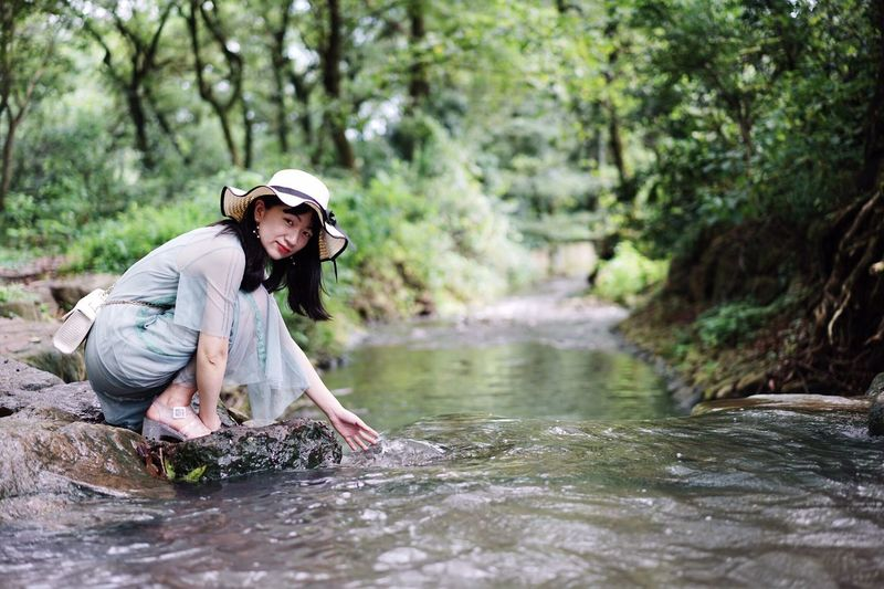Portrait Of A Woman Portrait Beauty In Nature Stream Waterfront Weekend Water One Person River Forest Nature Plant Leisure Activity Outdoors Stream - Flowing Water