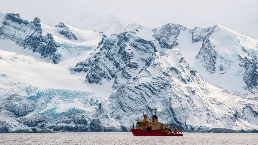 The Research Vessel/Ice Breaker Nathaniel B. Palmer in front of the majestic South Georgia coast, while working on Annenkov Island. Antarctica