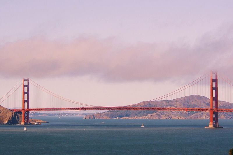 Boat Bridge Pastel Power Bridges Built Structure California Cloud Cloud - Sky Connection Development Dusk Engineering Golden Golden Hour International Landmark Long Outdoors Railing River Sky Structure Sunset Suspension Bridge Travel Water