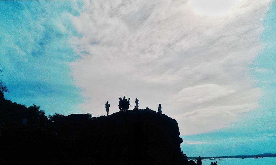 Silhouette Sky Leisure Activity Low Angle View Men Togetherness Lifestyles Friendship Outline Cloud Person Cliff Cloud - Sky Nature Outdoors Cloudy Tranquility Day Blue Beauty In Nature TakeoverContrast