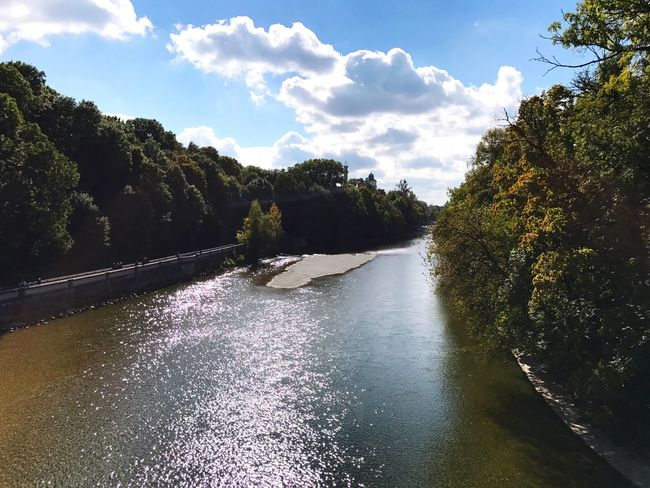 The Isar Banks in Munich. Tree River Sky Tranquil Scene Scenics Tranquility Waterfront Cloud Day Growth Calm Beauty In Nature Outdoors Cloud - Sky Riverbank Green Color Remote Green Isar Munich Isarufer