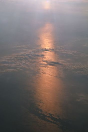 Cloud - Sky Beauty In Nature Sunset Water Sky Scenics - Nature Tranquility Reflection No People Nature Tranquil Scene Idyllic Sea Outdoors Fog Aerial View Cloudscape High Angle View