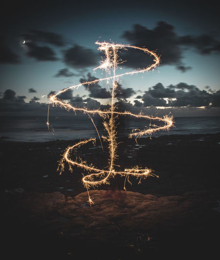 Long exposure of a sparkler HUAWEI Photo Award: After Dark Arts Culture And Entertainment Beauty In Nature Celebration Cloud - Sky Event Firework Glowing Illuminated Land Light Long Exposure Motion Nature Night No People Outdoors Scenics - Nature Sky Water