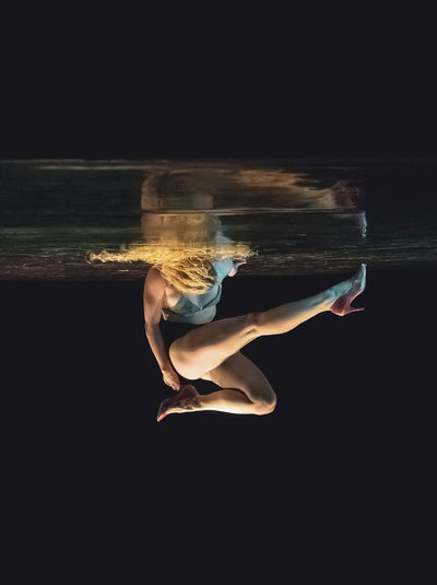 The Week on EyeEm Adult barefoot Beautiful Woman Beauty Black Background Clothing Dancing Elégance Flexibility Full Length Hairstyle Indoors  One Person Performing Arts Event Sea Side View Studio Shot Swimming Pool Underwater Water Women Young Adult Young Women The Fashion Photographer - 2018 EyeEm Awards