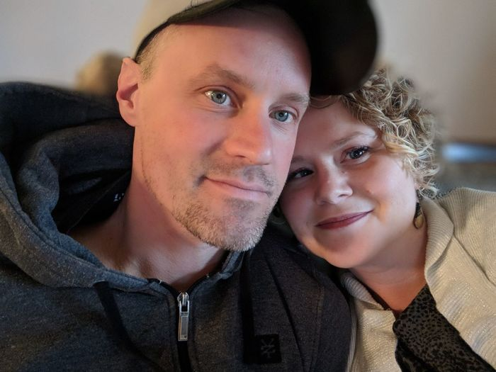 Portrait of smiling romantic couple sitting at home