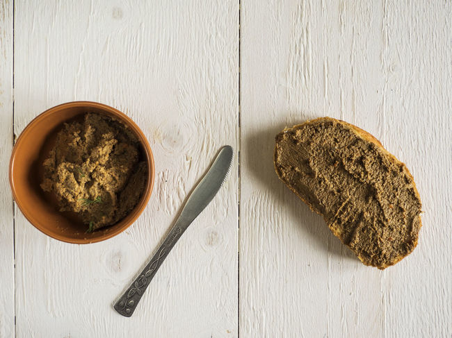 Bruschetta with liver pate on old wooden weathering background Background Bruschetta Circle Directly Above Green Color Herbal Medicine High Angle View Indoors  Liver No People Old Pate Plant Seasoning Spice Table Weathering Wooden