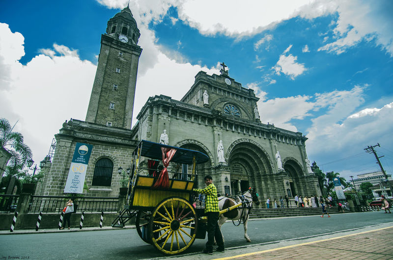 Carousel Manila Cathedral Cathedral Kalesa Horseride Carousel Street Streetphotography Street Photography City History Clock Tower Sky Architecture Building Exterior Cloud - Sky Travel Triumphal Arch Civilization Ancient Civilization Place Of Worship