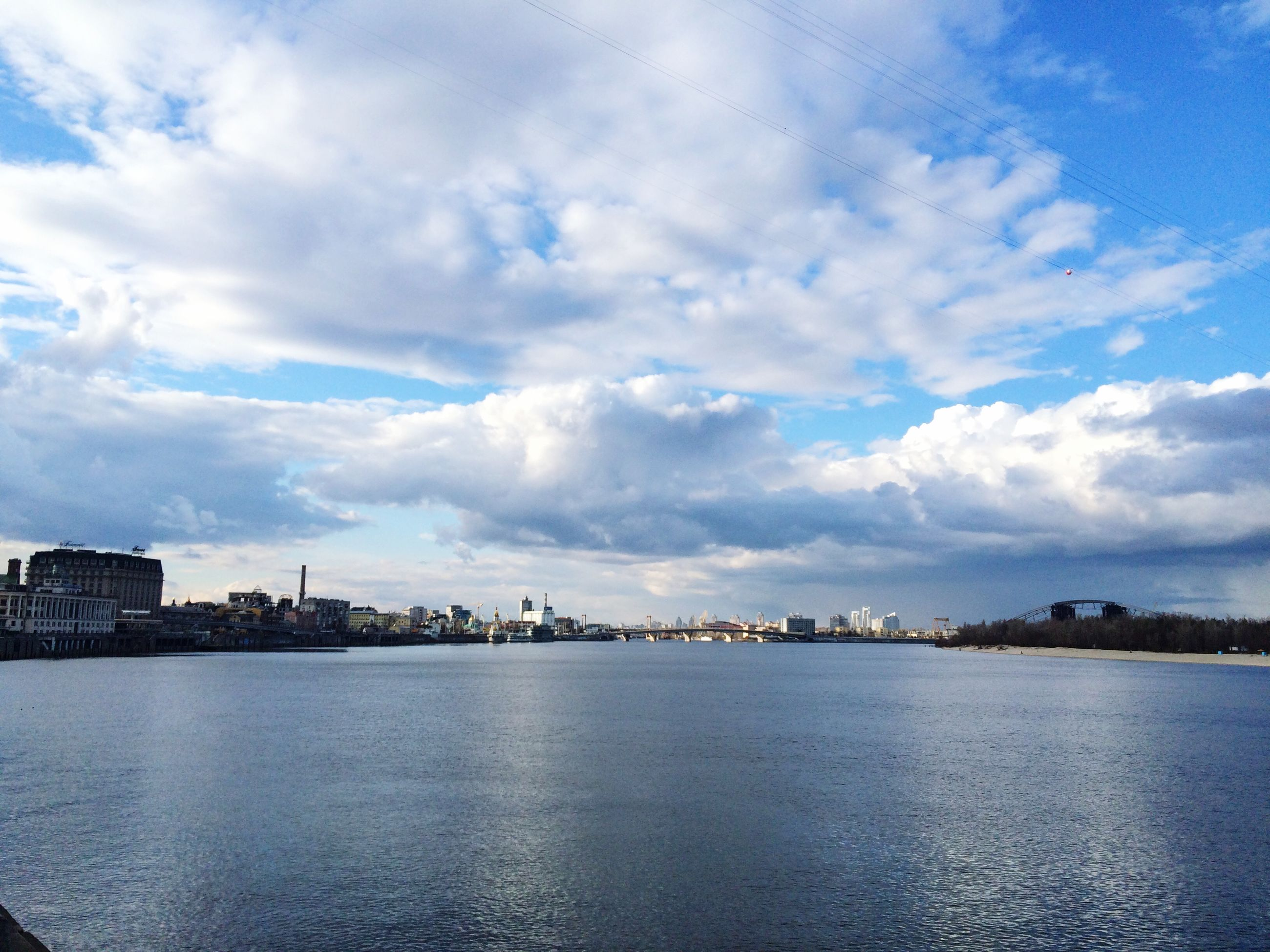 water, waterfront, sky, sea, cloud - sky, building exterior, architecture, built structure, cloud, city, rippled, river, cityscape, cloudy, blue, scenics, tranquility, tranquil scene, nature, beauty in nature