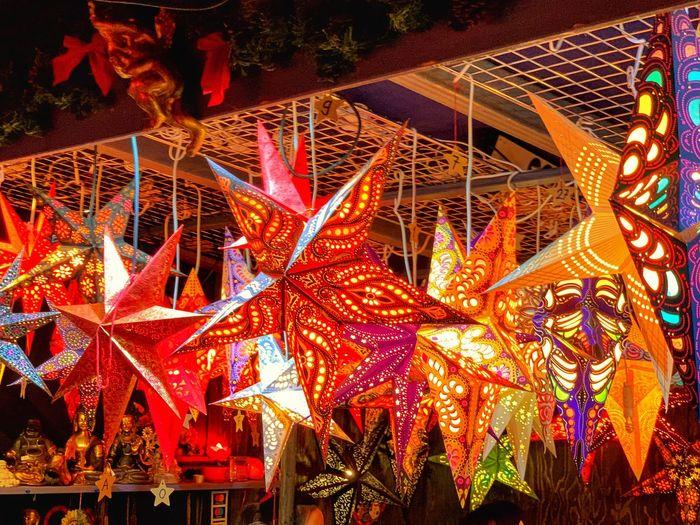 Low angle view of illuminated lanterns hanging at night