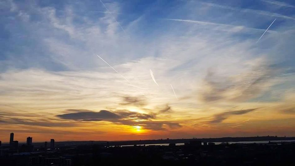 Sunset Flying Outdoors City Airplane Sky Dramatic Sky No People Vapor Trail Cloud - Sky Low Angle View Air Vehicle Scenics Nature Airshow Night Architecture