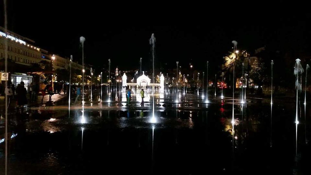 night, reflection, illuminated, built structure, building exterior, architecture, water, city, travel destinations, outdoors, no people, reflecting pool, sky, cityscape