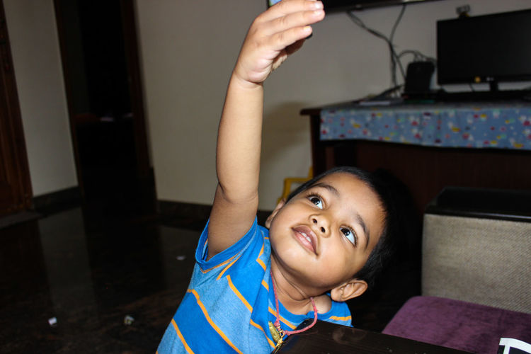 Cute boy playing at home
