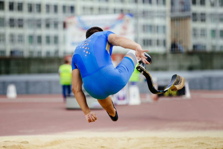 Rear view of male athlete with amputated leg