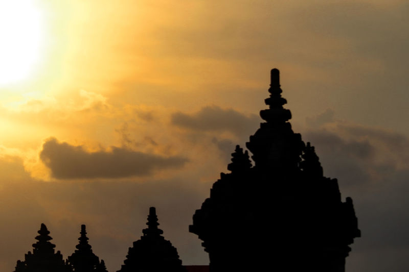 Silhouette temple against sky during sunset