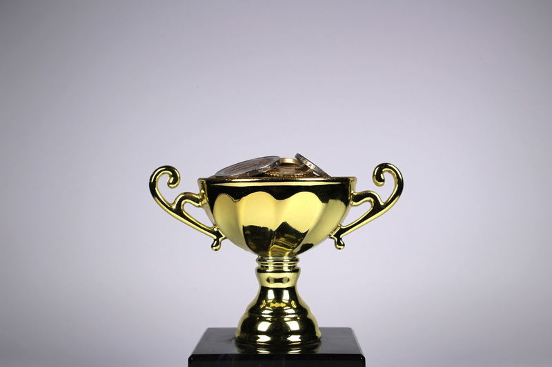 Achievement Coin Cup Euro Goal Gold Gold Trophy Golden Cup Savings Shiny Single Object Studio Photography Studio Shot Success Trophy White Background Winner Winning