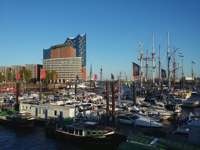 Hamburg Harbor with Elbphilharmonie. · Germany 040 Hamburgmeineperle Hamburger Hafen Opéra Operahouse Harbor View Port Boats Boats⛵️ Seaside Water Blue Sky