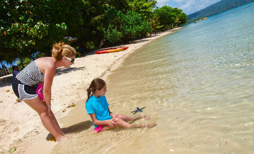 Pele Island Vanuatu Beach Child Childhood Females Full Length Girls Melanesian Outdoors Pacific Pacific Ocean People Playing Sand Star Fish Summer Swimwear Tam Tam Togetherness Tourism Travel Travel Destinations Two People Vacations Vivid International Water