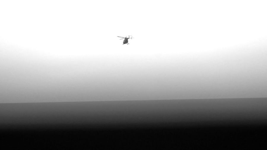 Black and white scenery of helicopter going away in 16x9 format sky. Copter Helicopter Black In Sky Horizon Line Bnw Vehicle Mode Of Transportation Helicopter Ride Air Vehicle Black Gradient Black And White 16x9