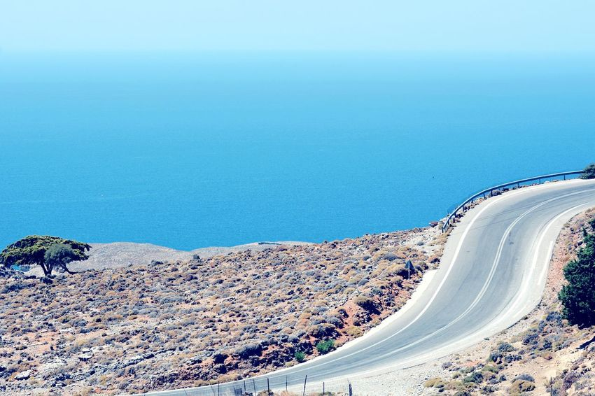 EyeEm Selects Nature Landscape Road Sky Blue Winding Road Outdoors No People Day Beauty In Nature Clear Sky Scenics Water Sea And Sky The Week On EyeEm View in Crete Island , Greece