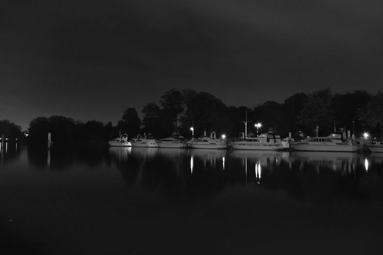 Alonetime Atmosphere Atmospheric Mood Blackandwhite Boat Dare To Be Different Early Morning Harbor Horizontal Symmetry Idreamofbeingthebest Lake Majestic Moored Showcase: January No People Outdoors Reflection_collection River Sailboat Sky Time To Reflect Tranquil Scene Tranquility Water Waterfront