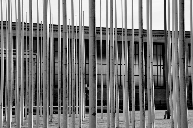 The Street Photographer - 2017 EyeEm Awards Full Frame No People Eyemphotography Eyemcity Berliner Ansichten Messe Berlin Fahnenmast Flag Pole Bnw_collection Black & White Schwarzweißfotografie Black/white Monochrome Noir Et Blanc Lines And Patterns Lines Wood Streetphotography Outdoors