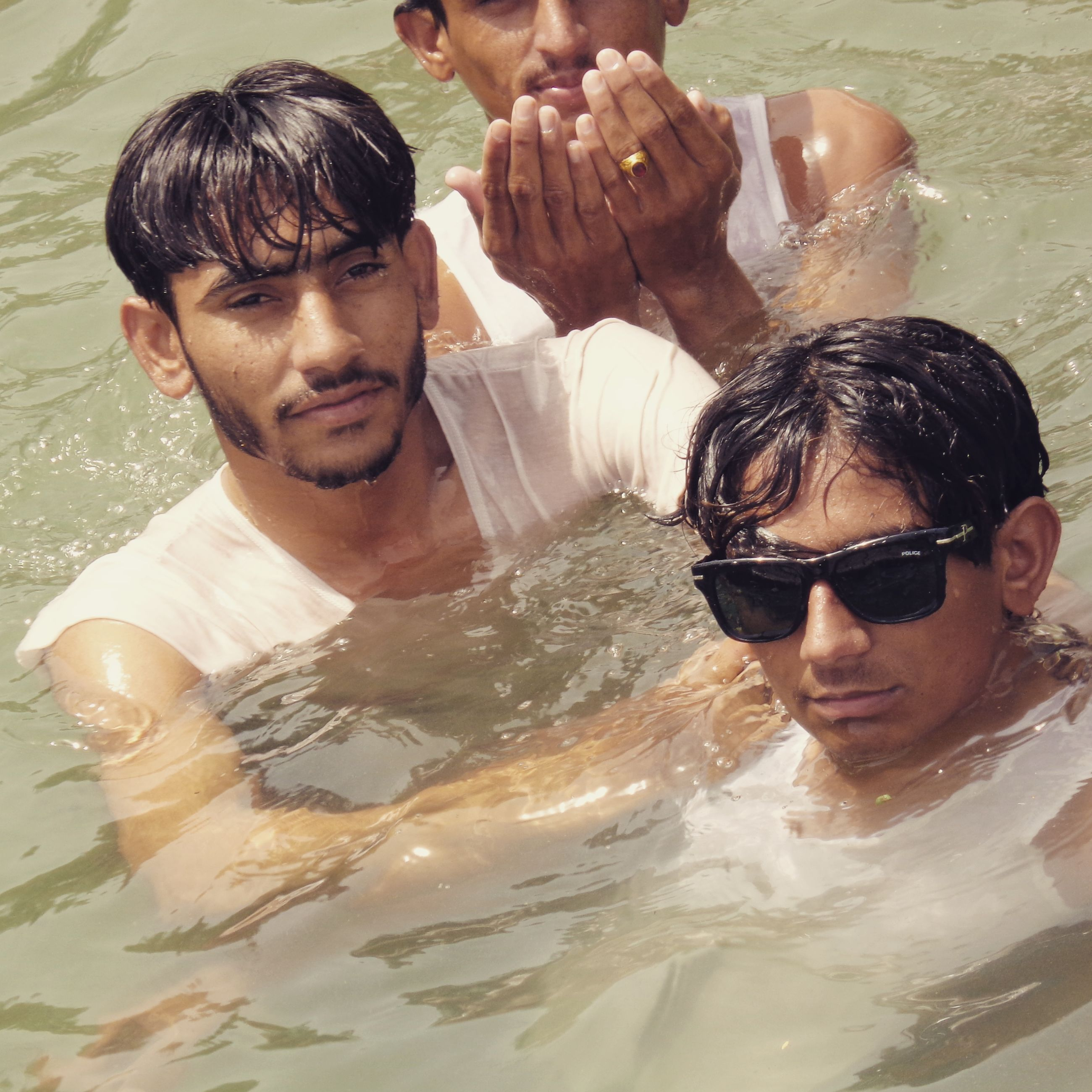 person, lifestyles, leisure activity, togetherness, water, bonding, looking at camera, boys, happiness, childhood, portrait, elementary age, smiling, casual clothing, young men, young adult, love
