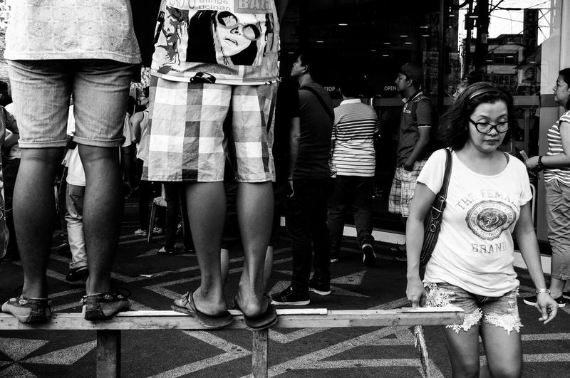 Girls on Eye glasses: Flaneuring in Black and White Black And White Blackandwhite Casual Clothing City Life Day Eyeem Philippines Eyeglasses  Flaneur My City Philippines Quezon Province Street Street Photography Streetphoto_bw Streetphotography Urban Urbanphotography