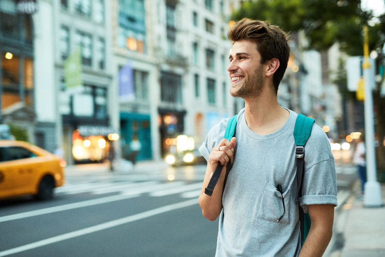 Young man standing in city
