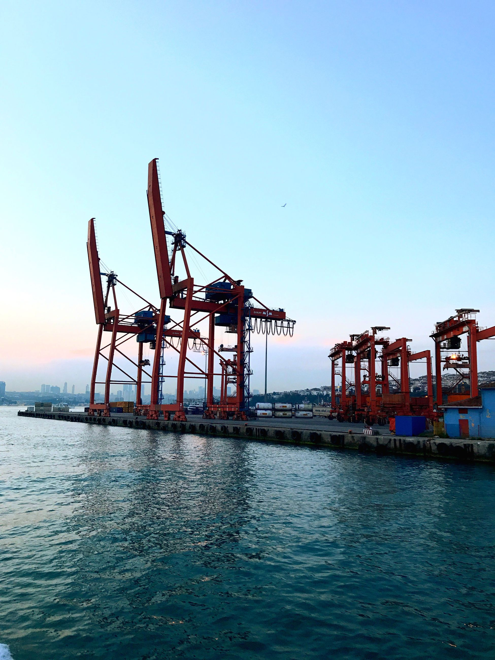 waterfront, water, clear sky, sea, crane - construction machinery, industry, outdoors, sky, freight transportation, day, transportation, commercial dock, blue, built structure, nature, nautical vessel, no people, scenics, harbor, architecture, beauty in nature, offshore platform, drilling rig, oil pump